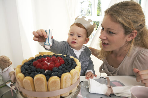 Mother and daughter celebrating little girl's first birthday with self-made fancy cake - FSF000227