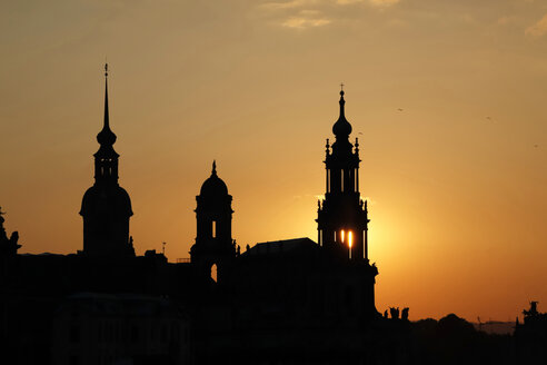 Germany, Saxony, Dresden, silhouettes of court church and castle at sunset - JTF000586