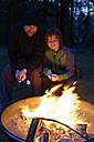 Father and son at the campfire roasting marshmallows - LBF000984