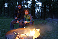 Father and son at the campfire roasting marshmallows - LBF000983