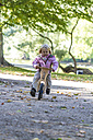 Little girl driving on balance bicycle - JFEF000511