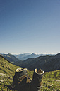 Austria, Tyrol, Tannheimer Tal, hiking boots in mountainscape - UUF002305