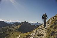 Austria, Tyrol, Tannheimer Tal, mature man hiking - UUF002308