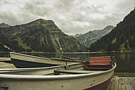 Austria, Tyrol, Tannheimer Tal, boats at mountain lake - UUF002328