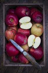 Wooden box of red apples and a pocket knife - LVF002075