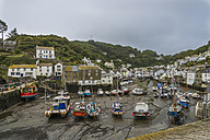 UK, Cornwall, Polperro, Boats at fishing harbour during low tide - FR000049