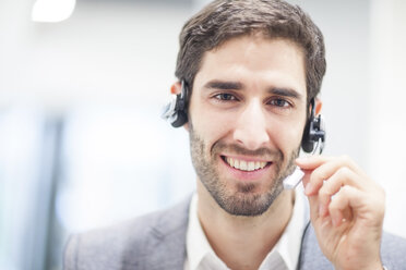Portrait of smiling man with headset - ZEF007941