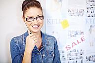 Portrait of female creative professional beside white board - ZEF001517
