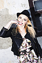 Portrait of fashionable blond woman with finger in her mouth - DAWF000224