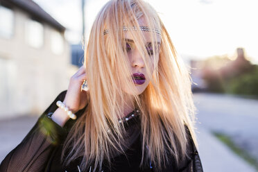 Portrait of rouged blond woman with strands of hair on her face - DAWF000243