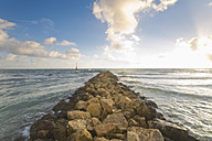 Spain, Baleares, Mallorca, waves reaching breakwater at the seafront - MSF004323