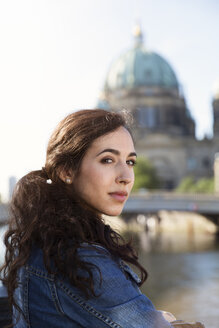 Germany, Berlin, portrait of young female tourist on city trip - FKF000706