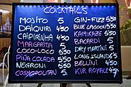 Spain, Ibiza, Santa Eulalia, board with cocktails at a bar - NDF000477
