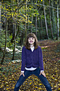 Girl standing in autumnal forest - LVF002082