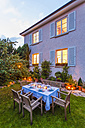 Autumnal laid table in garden in the evening - WDF002732
