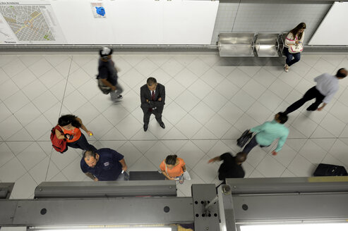 Brazil, Sao Paulo, man waiting at metro statio, view from above - FLK000523