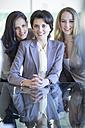 Portrait of three smiling businesswomen - ZEF002162