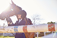 Young woman with horse on show jumping course - ZEF001877