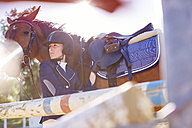 Young woman with horse on show jumping course - ZEF001765