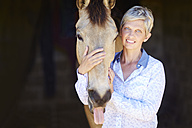 Portrait of smiling woman with horse - ZEF001769