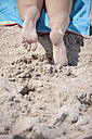 Legs of young woman lying on beach - ZEF002457