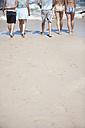 Friends walking on beach - ZEF002462