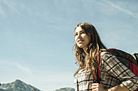Austria, Tyrol, Tannheimer Tal, smiling young woman on hiking trip - UUF002419