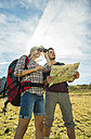 Austria, Tyrol, Tannheimer Tal, young couple hiking with map and binocular - UU002428