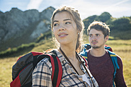 Austria, Tyrol, Tannheimer Tal, young couple hiking - UUF002429
