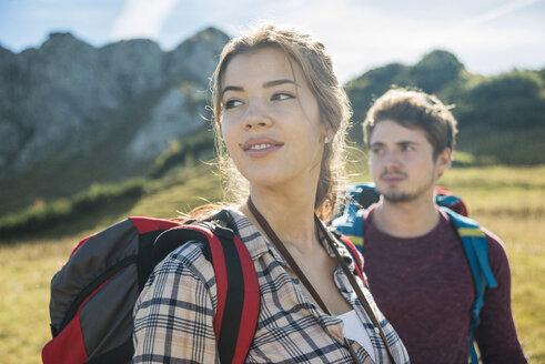 Austria, Tyrol, Tannheimer Tal, young couple hiking - UUF002429