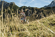 Austria, Tyrol, Tannheimer Tal, young couple hiking - UUF002431