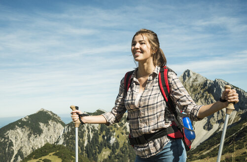 Austria, Tyrol, Tannheimer Tal, smiling young woman on hiking trip - UUF002443