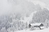 Austria, Salzburg State, Flachau, Farmhouse in winter - HHF004943