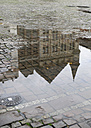 Germany, North Rhine-Westphalia, Aachen, building reflecting in a puddle - HLF000758
