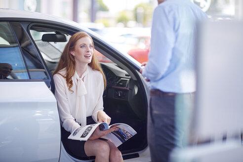 Car dealer talking to client - ZEF002132