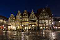 Germany, Bremen, view to row historic houses at marketplace by night - SJF000128