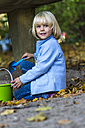 Portrait of little girl playing with sandbox toys - JFEF000518