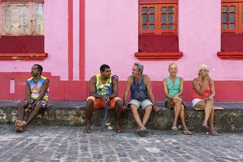 South America, Brazil, Olinda, people sitting on pavement - FP000013