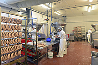 Women working at sausage production in a butchery - LYF000314