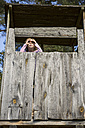 Girl in tree house looking at distance - OJF000073