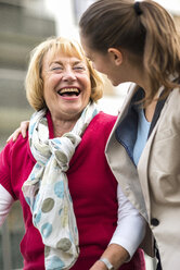 Portrait of laughing senior woman communicating with her granddaughter - UUF002538