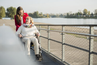 Germany, Baden-Wurttemberg, Mannheim, Granddaughter spending time with garndmother in wheelchair - UUF002599