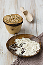 Bowl of Einkorn wheat, Triticum monococcum, shovel and bowl of whole meal - MYF000689