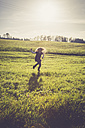 Little girl jumping on a meadow in backlight - SARF001005