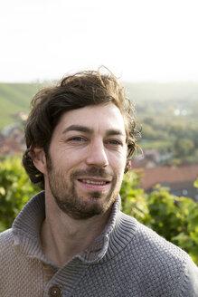 Germany, Bavaria, Volkach, portrait of winegrower in vineyard - FKF000773