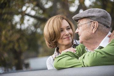 Confident senior man with daughter outdoors - UUF002641