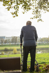 Senior man with wheeled walker by the riverside - UUF002676