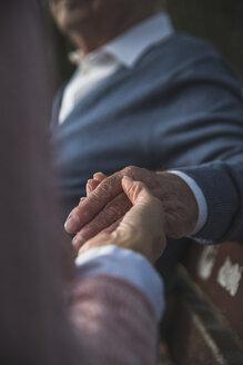 Daughter holding hand of senior man - UUF002677