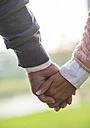 Daughter holding hand of senior man - UUF002684