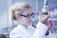 Young scientist working in a lab - SGF001025